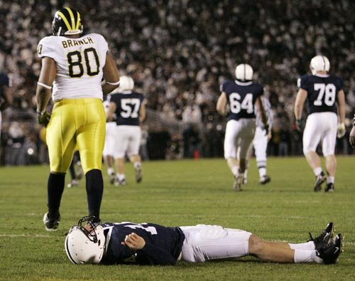 *Alan Branch knocks out PSU quarterback Anthony Morelli, photo taken from maizenbrew.com