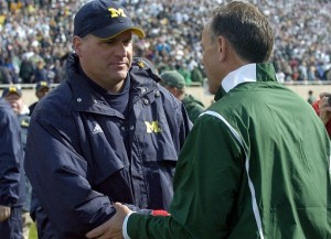 *Rodriguez shakes hands with MSU coach Mark Dantonio after the game, photo by Lon Horwedel | AnnArbor.com