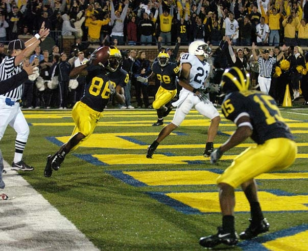 *Mario Manningham catches the winning touchdown pass in 2006, photo by RYAN WEINER/DAILY