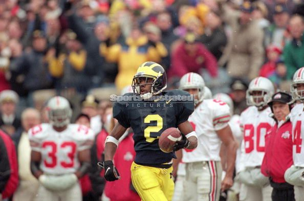 *Charles Woodson's punt return against Ohio State helped Michigan secure the Big Ten title and trip to the Rose bowl, photo by Damian Strohmeyer/Sports Illustrated/Getty Images