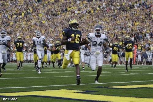 Robinson shattered the Michigan single-game rushing record for a quarterback, set by Steve Smith who ran for 147 yards on four carries on Nov. 12, 1983