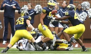 UM linebacker Obi Ezeh (45) recovers a UConn fumble inside the Wolverines' five-yard line (Photo from the Toledo Blade)