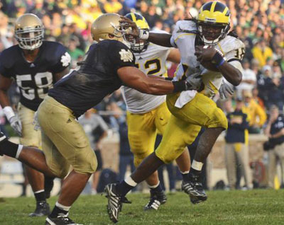 Denard doing his Heisman thing, photo by Sam Wolson / The Michigan Daily