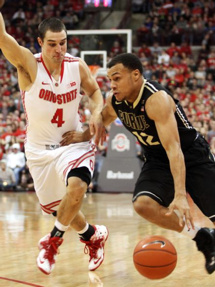If Nik Stauskas draws Aaron Craft Michigan will need other scorers to step up (Mike Munden, AP)