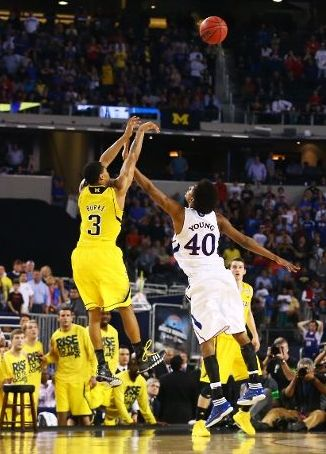 Trey Burke's three against Kansas last March kept Michigan's Sweet Sixteen success intact (Ronald Martinez, Getty Images)
