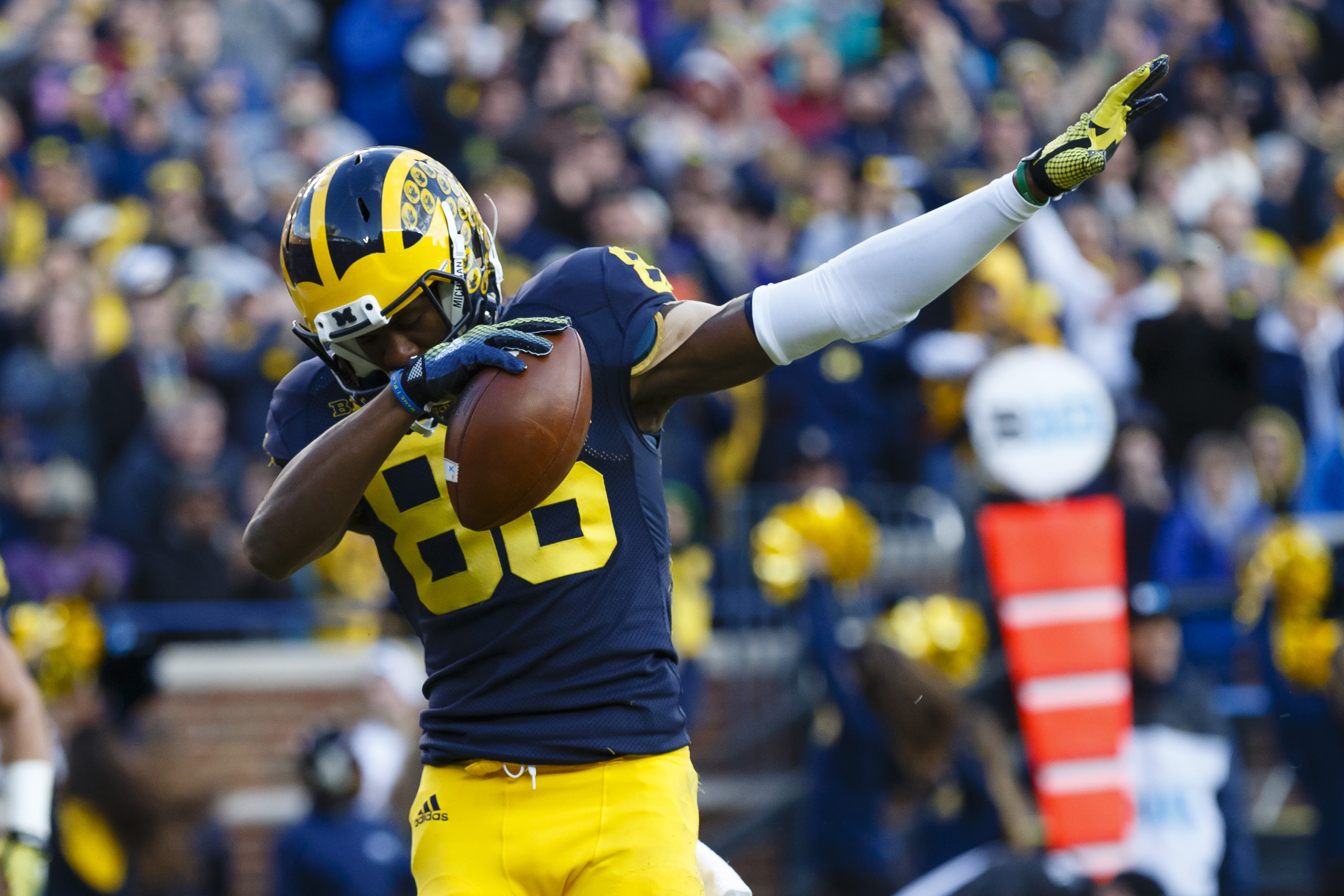 Nov 7, 2015; Ann Arbor, MI, USA; Michigan Wolverines wide receiver Jehu Chesson (86) celebrates his touchdown in the first quarter against the Rutgers Scarlet Knights at Michigan Stadium. Mandatory Credit: Rick Osentoski-USA TODAY Sports